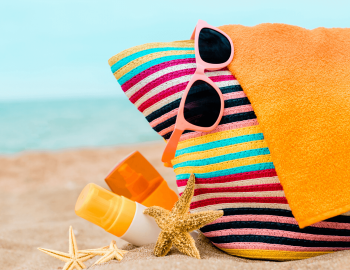 beach bag packed with sunglasses towels etc