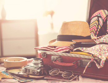 packing for the beach summer suitcase
