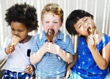 cute kids enjoying ice cream in the summer messy