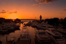 sunset on hilton head marina lighthouse in the background